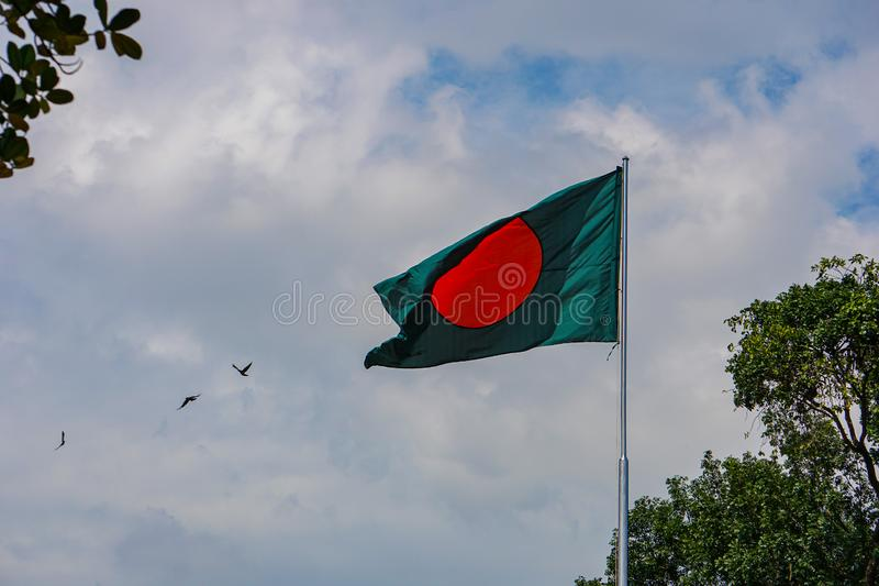 Flag of the Bangladesh, Freedom Square, Shahbagh-Dhaka-Bangladesh. The flag, a green background with a red circle symbolising the rising sun nestled in royalty free stock image