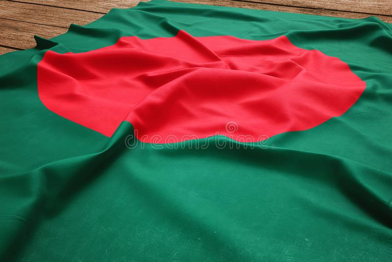 Flag of Bangladesh on a wooden desk background. Silk Bangladeshi flag top view royalty free stock photography