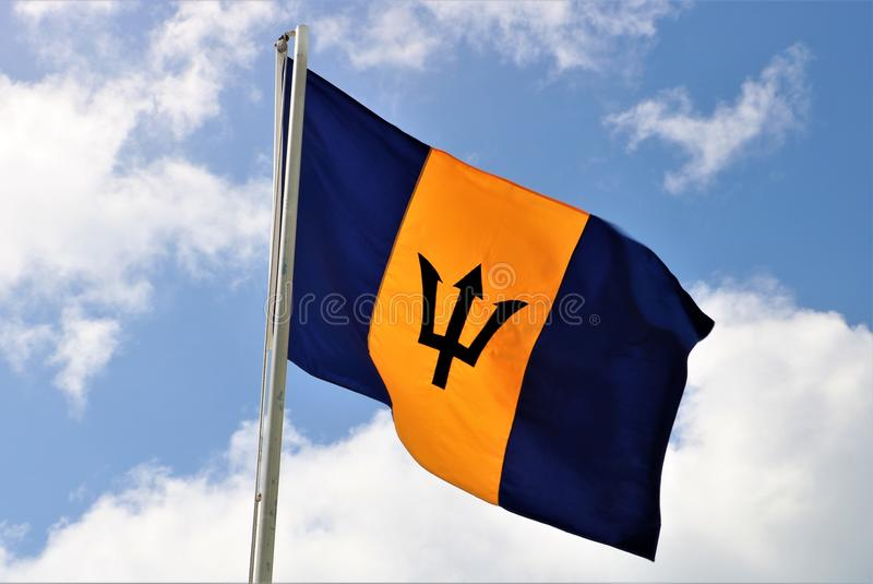Flag of Barbados. It was officially adopted on 30 November 1966, the island`s first Independence Day. It consists of a triband of two bands of ultramarine stock photography