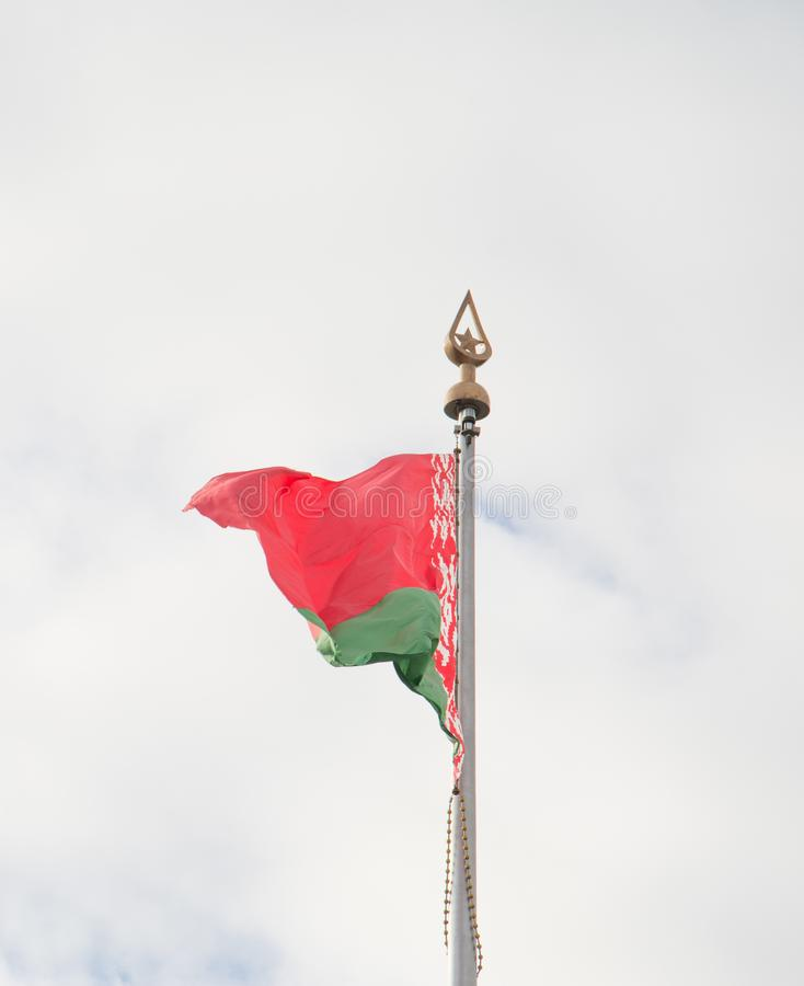 Flag of Belarus at the clouds sky background royalty free stock photos