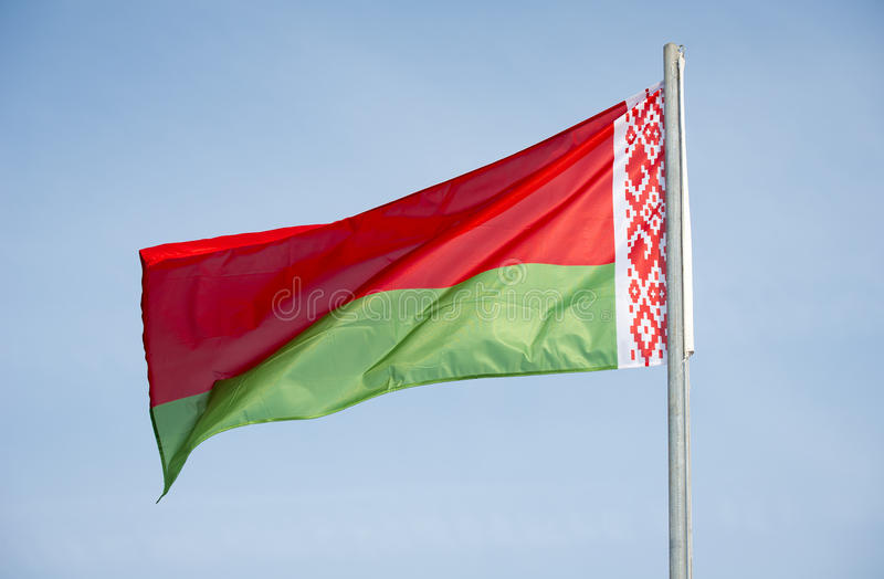 Flag of Belarus. Over blue sky background stock photo