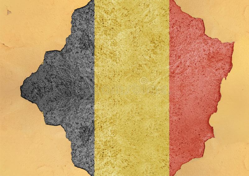 Flag of Belgium in big broken material concrete cracked hole facade. Structure stock photo
