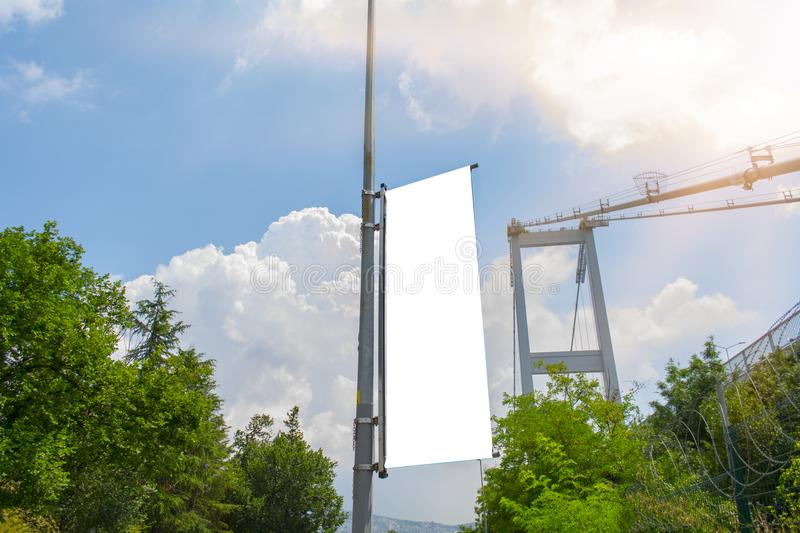Flag blank mockup on a perfect sky with cloudy, blue and sun reflection background in istanbul street; Turkey.  royalty free stock image