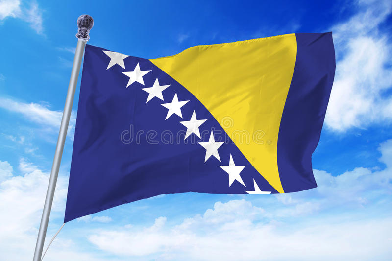 Flag of Bosnia and Herzegovina developing against a clear blue sky. On a sunny day stock images