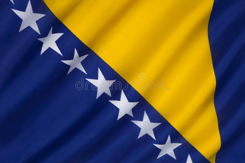 The flag of Bosnia and Herzegovina - Europe. Flag of Bosnia and Herzegovina. The three points of the triangle stand for the three peoples of Bosnia and royalty free stock image
