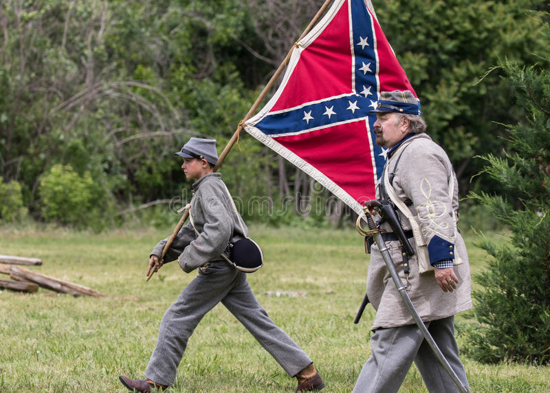 Flag Boy. Civil War era soldiers in battle at the Dog Island reenactment in Red Bluff, California stock image