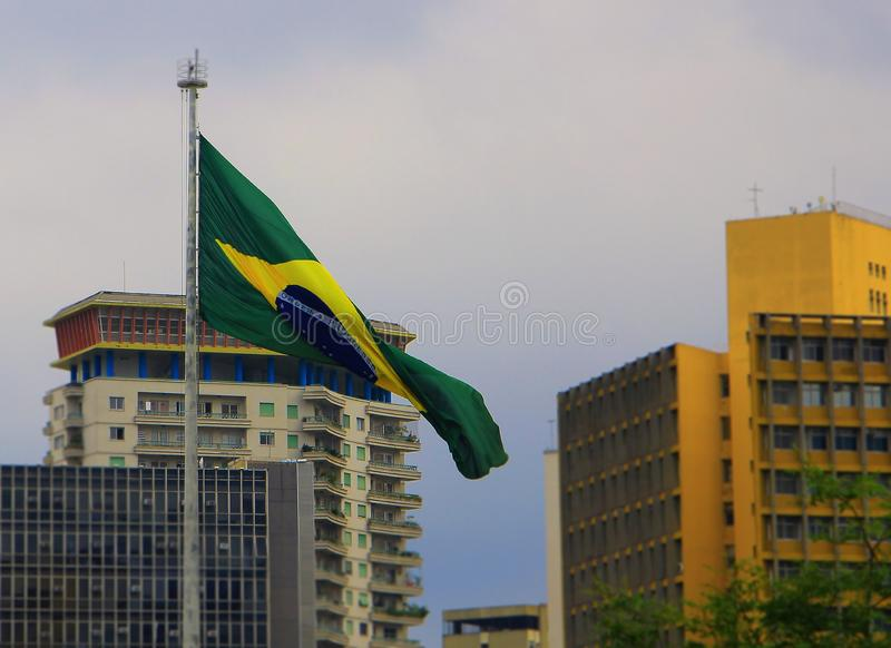 Flag of Brazil between buildings. royalty free stock photos