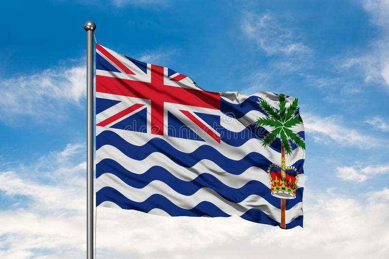 Flag of British Indian Ocean Territory waving in the wind against white cloudy blue sky royalty free stock images