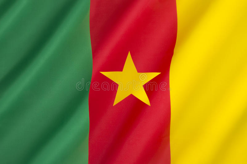 Flag of Cameroon. Adopted in its present form on 20th May 1975 after Cameroon became a unitary state. The color scheme uses the traditional Pan-African colors stock photo