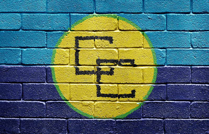 Flag of the Caribbean Community on brick wall. Flag of the Caribbean Community painted onto a grunge brick wall stock image