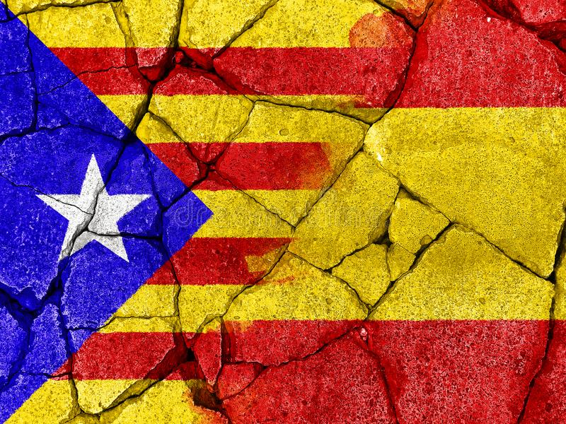 flag of Catalonia on crack cement to communicate the split between Spain and Catalan country stock images