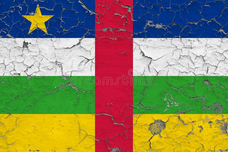 Flag of Central African Republic painted on cracked dirty wall. National pattern on vintage style surface royalty free stock photography