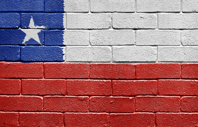 Flag of Chile on brick wall. Flag of Chile painted onto a grunge brick wall stock photography