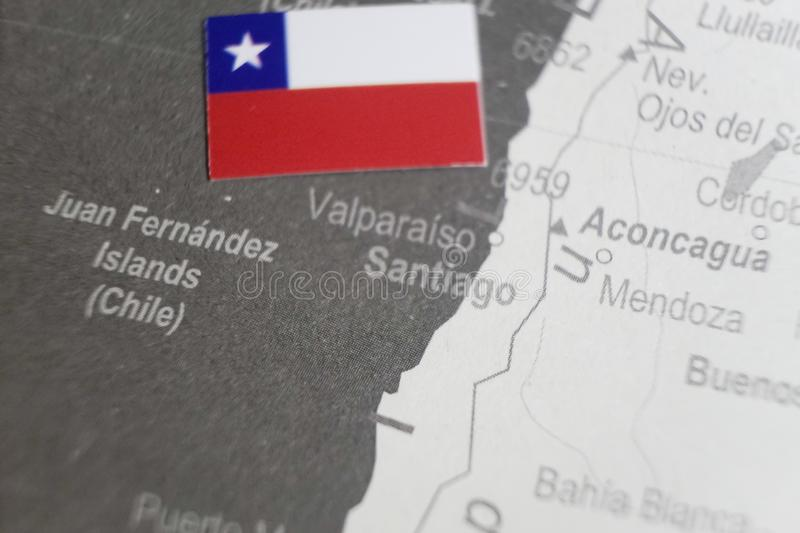The flag of Chile placed on Santiago map of world map stock image