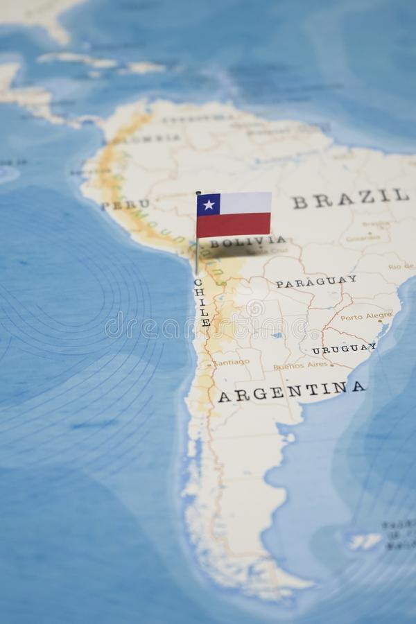 The Flag of chile in the world map royalty free stock image