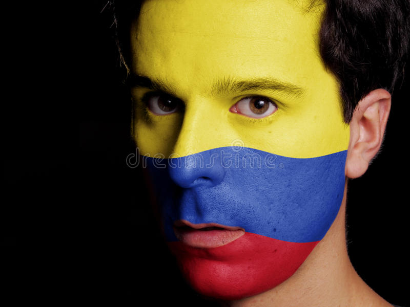 Flag of Colombia. Painted on a Face of a Young Man stock photo