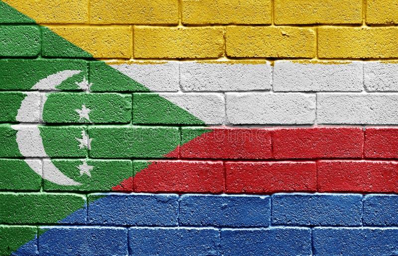 Flag of Comoros on brick wall royalty free stock photo