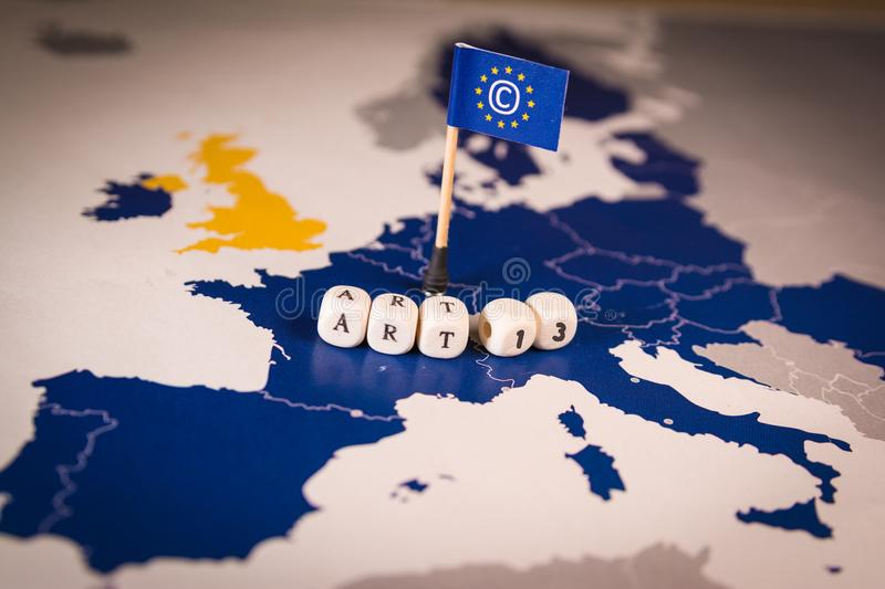 Flag with Copyright symbol over a EU map. CDSM metaphor. Flag with Copyright symbol over a EU map. Symbolizing the EU Directive on Copyright in the Digital stock photo