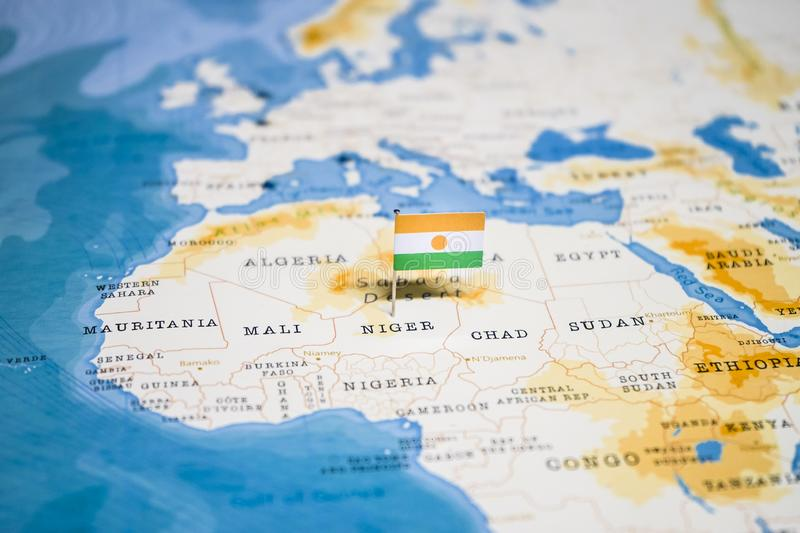The Flag of Niger in the World Map royalty free stock image