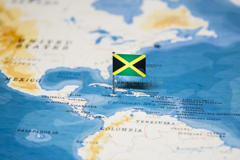 The Flag Of Jamaica In The World Map Stock Image - Image of ...