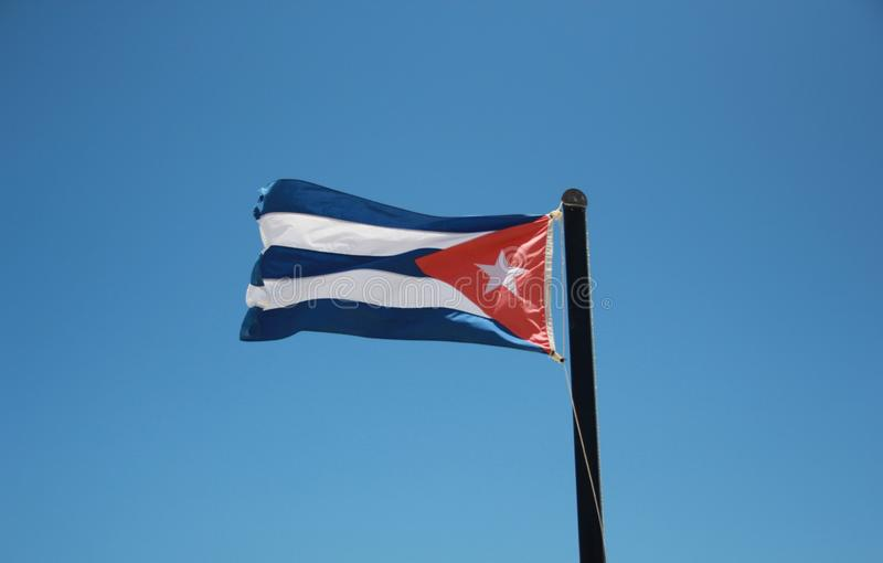 A large national flag of Cuba, fluttering in the breeze royalty free stock images