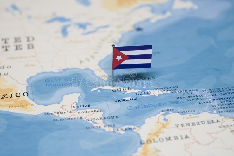 The Flag of cuba in the world map royalty free stock photo