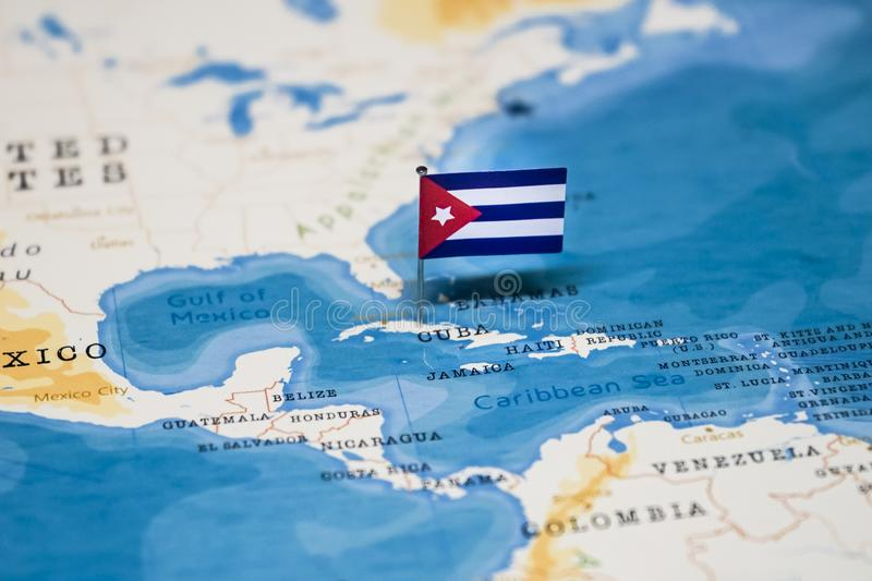 The Flag of Cuba in the World Map royalty free stock image