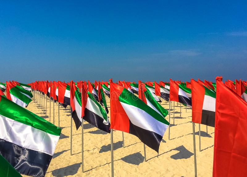 Flag day UAE. Many flags on the beach of Abu Dhabi. Flag day UAE. Many flags on the beach of Abu Dhabi stock image