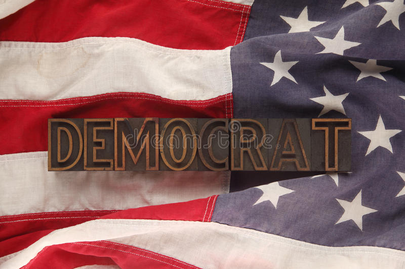 Flag with Democrat word. The word Democrat in letterpress wood type on an old American flag royalty free stock image