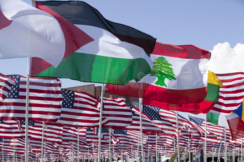 Flag Display. Flags of Japan, Jorden, Lebanon,Lithuania,Malaysia and Mexico infront of many United States of America Flags stock photography