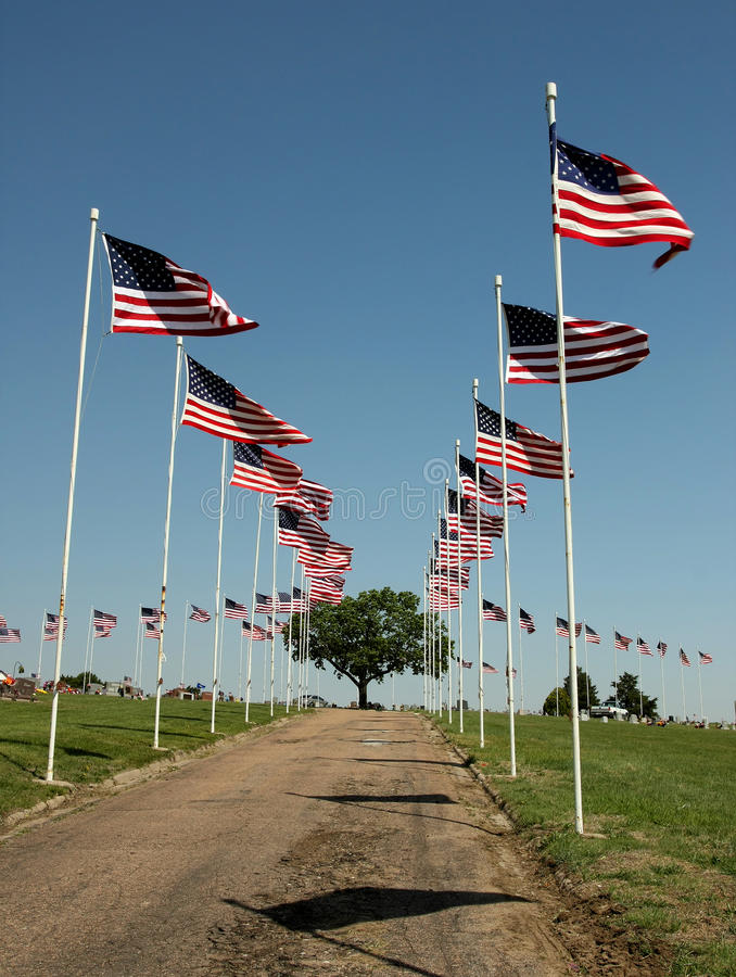 Flag Display on Cemetary on Memorial Day. Flad display lining drive at country cemetary on Memorial Day stock photos