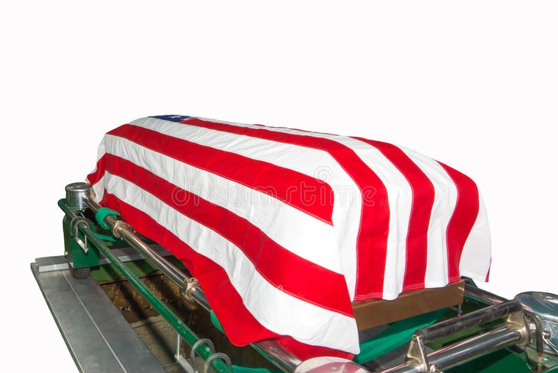 Flag draped casket with US Flag. Military funeral with US flag on casket royalty free stock images