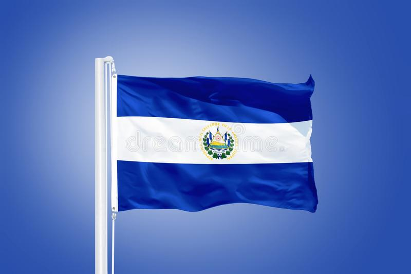 Flag of El Salvador flying against a blue sky.  royalty free stock photos