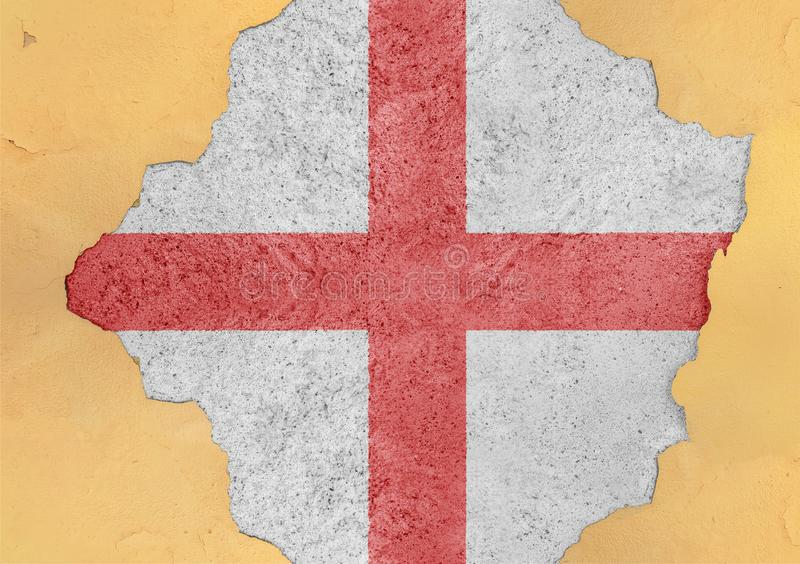 Flag of England in big broken material concrete cracked hole facade hole. Flag of England in big broken material concrete cracked hole facade structure royalty free stock photography