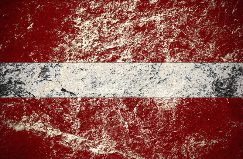 Flag of England or on stone wall. Flag of Latvia on grunge stone background stock photos