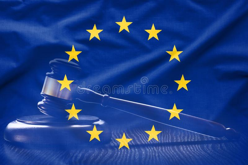 Flag of EU with court gavel in background stock photo