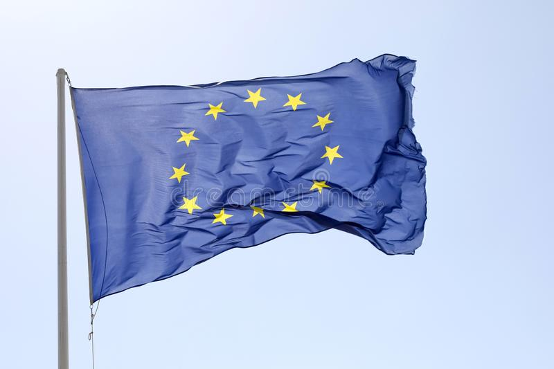 Flag of the European Union. The flag of the European Union blows with the wind royalty free stock photo
