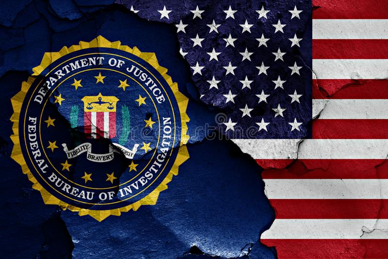 Flag of FBI and USA painted on cracked wall royalty free stock images