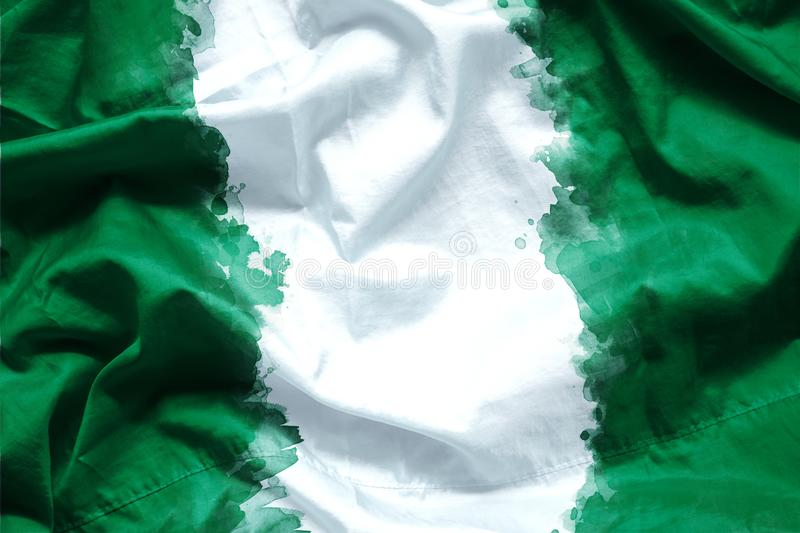 Flag Federal Republic of Nigeria by watercolor paint brush on canvas fabric, grunge style.  royalty free stock photo