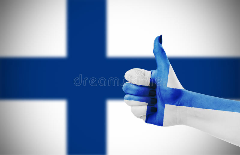 Flag of Finland. Over female's hand royalty free stock image