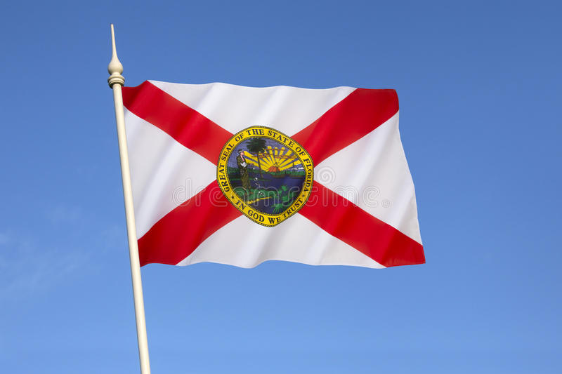 Flag of Florida - United States of America. The flag has a red saltire (St. Andrews Cross) on a white background, with the state seal in the center. The stock image