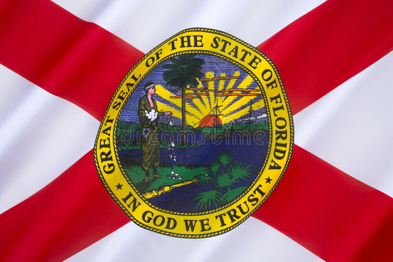 Flag of Florida - United States of America. The flag has a red saltire (St. Andrews Cross) on a white background, with the state seal in the center. The royalty free stock image