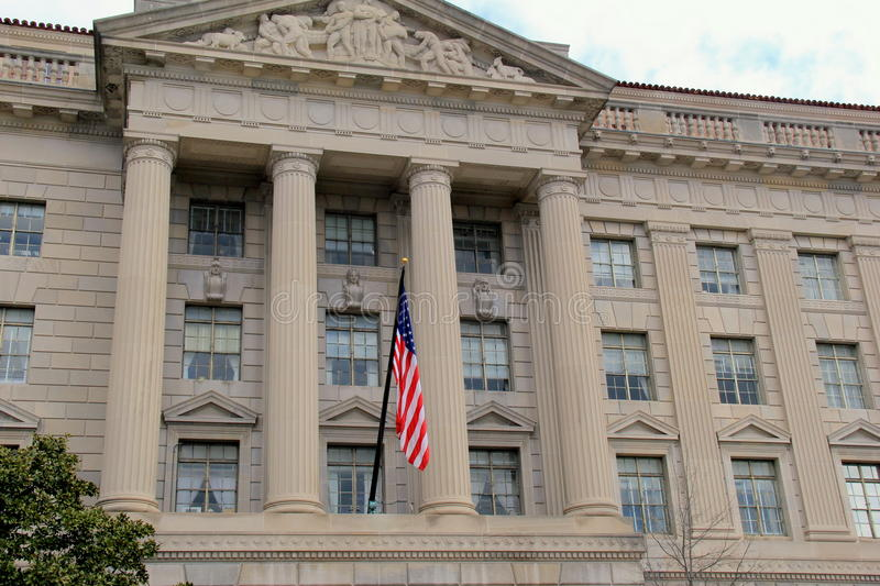 Flag flying in front of the Herbert C.Hoover Building,Washington,DC,2015 stock photo