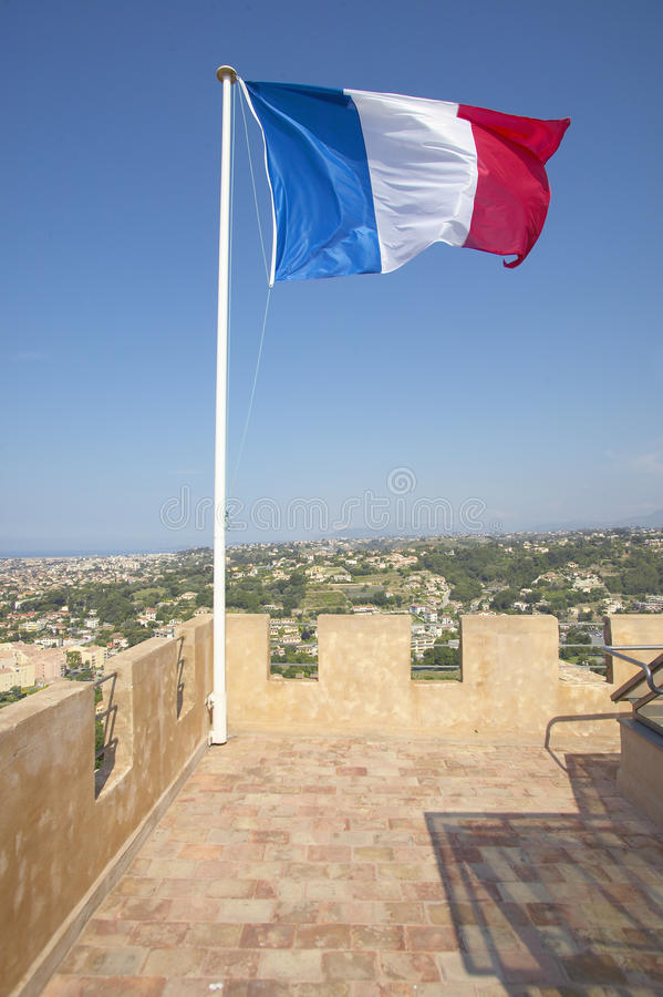 The flag of France flying from the Chateau Grimaldi, Haut de Cagnes, France stock photography