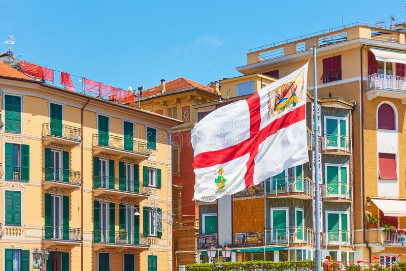 Flag of Genoa. In the wind in Rapallo, Italy royalty free stock images