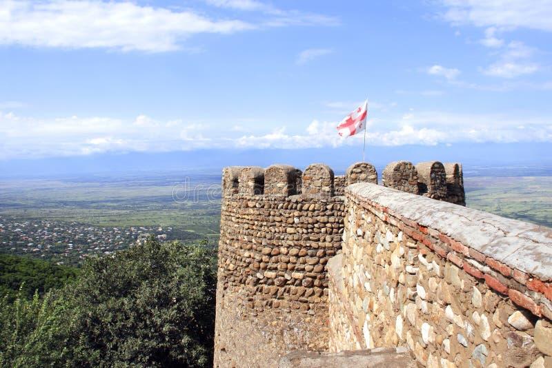 Flag of Georgia on medieval fortress wall, Sighnaghi, Georgia stock photos
