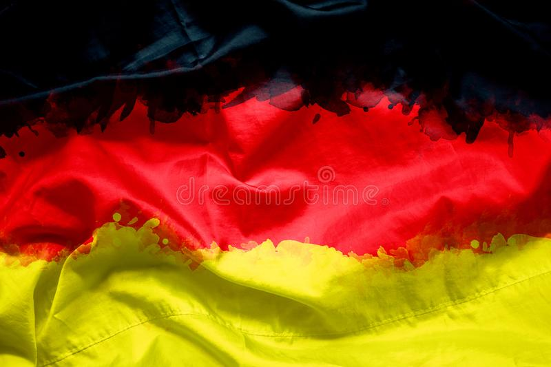 Flag of German Federal Republic of Germany by watercolor paint brush on canvas fabric, grunge style.  royalty free stock photos