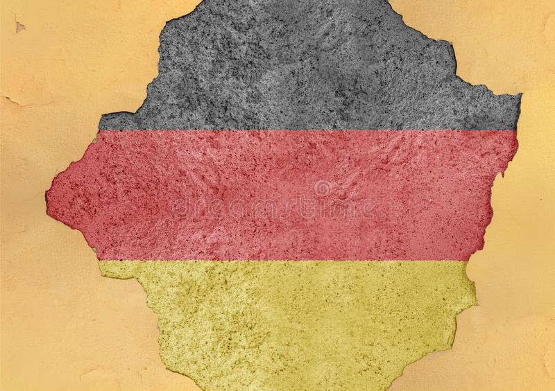 Flag of Germany in big broken material concrete cracked hole facade. Structure stock image