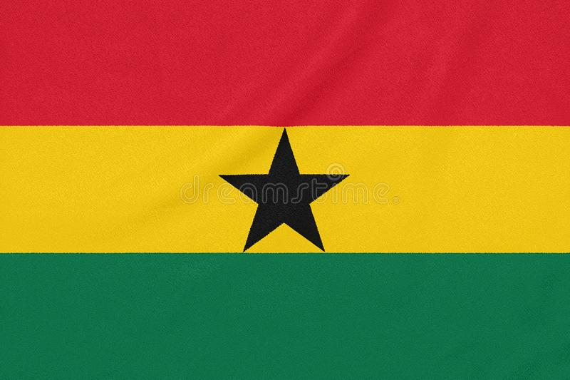 Flag of Ghana on textured fabric. Patriotic symbol.  royalty free stock photo