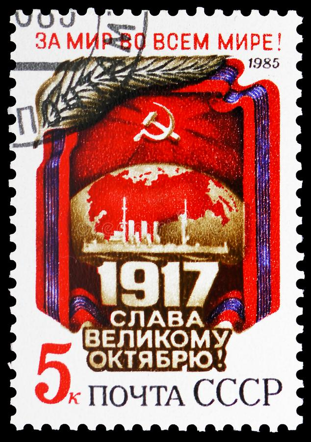 Flag, Globe, Cruiser \'Aurora\', October Revolution, 68th Anniversary serie, circa 1985. MOSCOW, RUSSIA - MAY 25, 2019: Postage stamp printed in Soviet Union ( royalty free stock photo